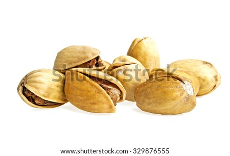Pistachio nuts on a white background - stock photo