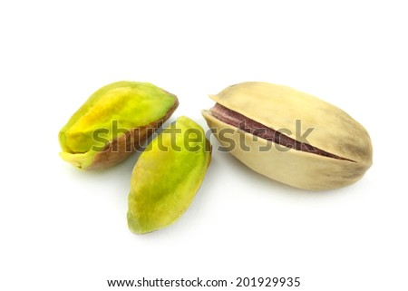 Pistachio nuts ( Real Turkish Antep nuts ) isolated on white background.  Extreme macro shot. - stock photo