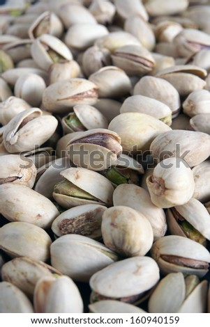 Pistachio nuts with selective focus on middle nut - stock photo