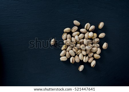 pistachio on dark background