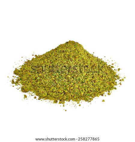 Pistachio powder pile isolated on white background - stock photo
