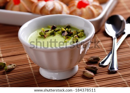 pistachio pudding in white ceramic bowl - stock photo