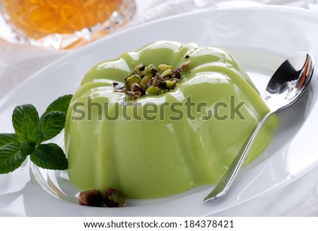 pistachio pudding on white plate - stock photo