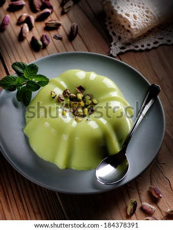 pistachio pudding with ingredients around - stock photo