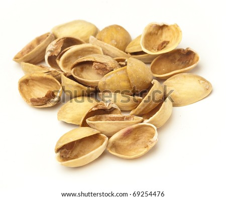 pistachio shells isolated on a white background - stock photo