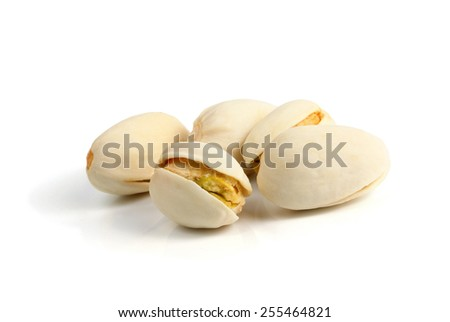 pistachios heap against white background