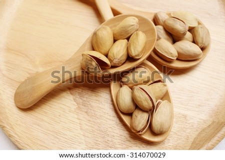 Pistachios nuts on a background of white