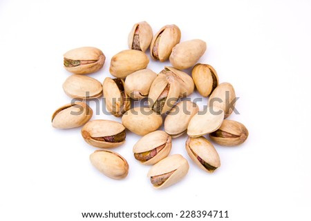 Pistachios on a white background seen from above - stock photo
