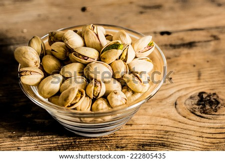 Pistachios on a wooden table  - stock photo