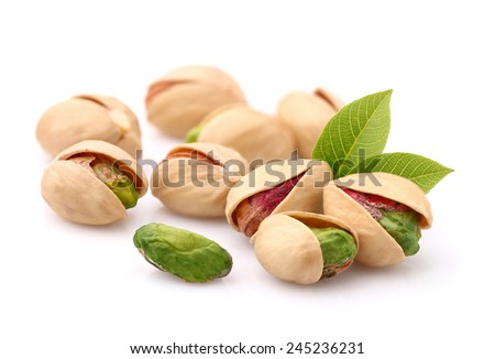 Pistachios with leaves - stock photo