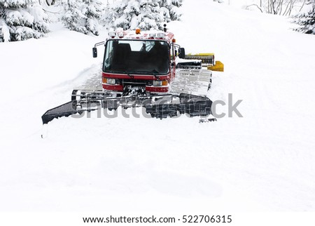 Piste machine (snow cat) - Snowmobile governing snowy mountain road