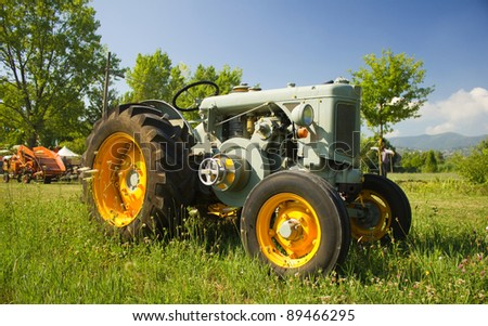 "PISTOIA, ITALY - JULY 10: Antique tractor on display during the agricultural machinery exhibition ""Battitura del grano"" on July 10. 2011 in Pistoia, Italy"