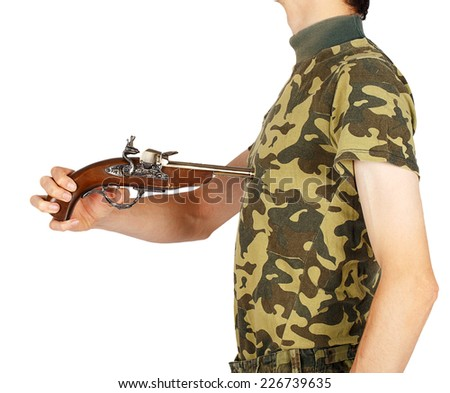 Pistol aimed at his chest man in military uniform on a white background - stock photo