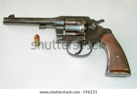 pistol and bullet - stock photo