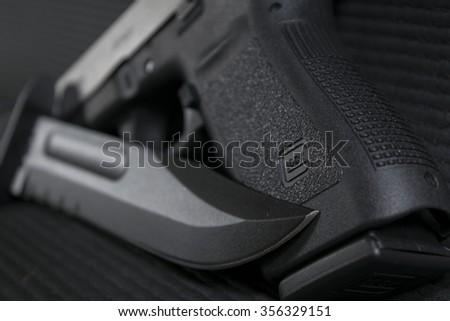 Pistol & Blade - stock photo