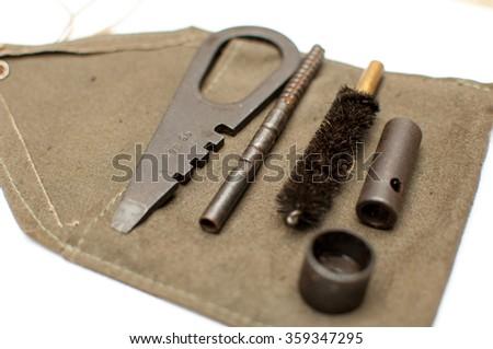 Pistol cleaning kit. - stock photo