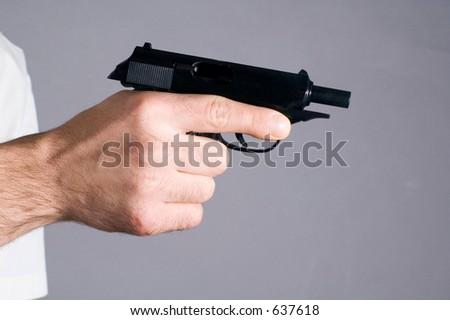 Pistol demanding unloaded - stock photo