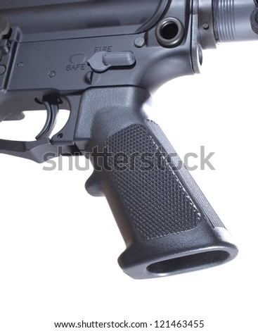 Pistol grip and trigger that are on an AR-15 - stock photo
