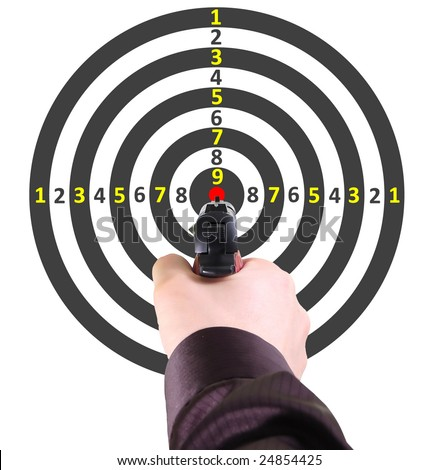 Pistol in a hand of the man against a target - stock photo