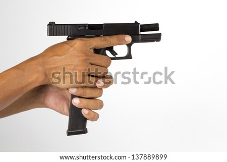 Pistol in hand isolated on white background - stock photo