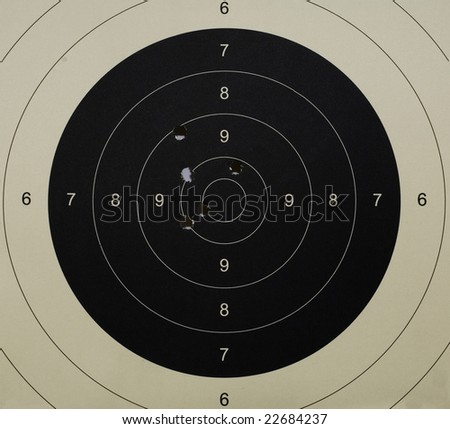 Pistol 25 meter target with 5 holes, 49 scored - stock photo