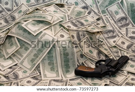 Pistol on a heap of money, Conceptual photo