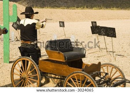 pistol shooting in a cowboy action shooting competition in Arizona - stock photo