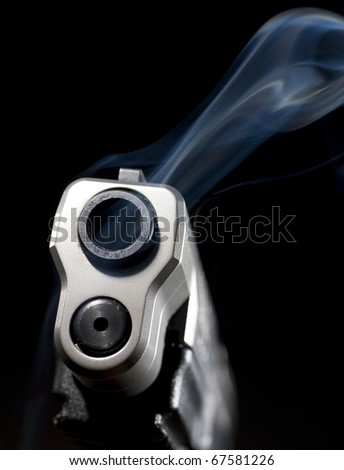 Pistol that is still releasing smoke after a shot