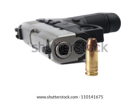 Pistol with ammunition on white background