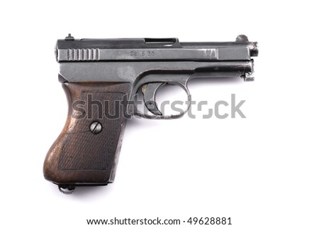 Pistol with clearly visible fingerprint - stock photo