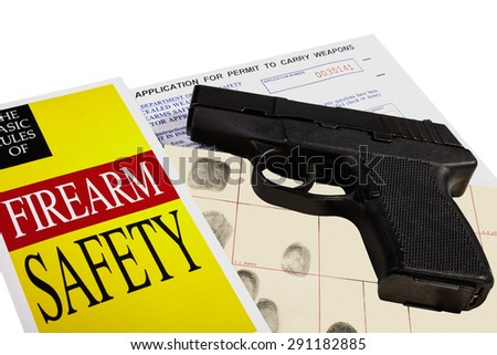 Pistol with Firearm Application and CCW Permit Fingerprint ID - stock photo