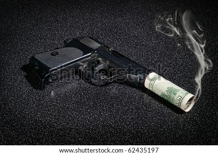 Pistol with imitation of silencer from dollar greenback and with smoke from barrel - stock photo