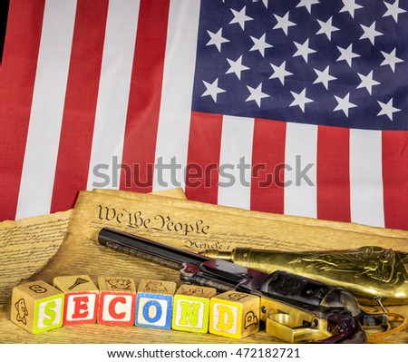 Pistol with the constitution and the work Second and the American Flag