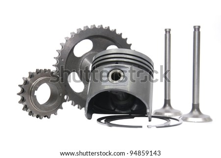 piston and other engine spareparts on isolated white background - stock photo