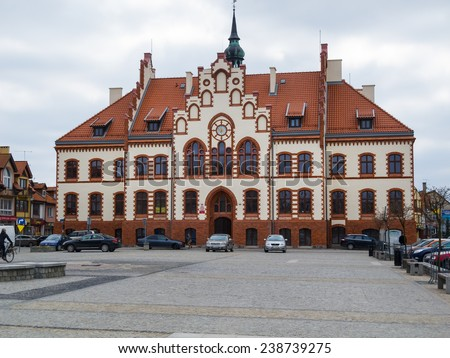 PISZ, POLAND - APRIL 11, 2014: Town hall in Pisz, built in 1900 , freshly renovated in 2013. Neogothic style - stock photo