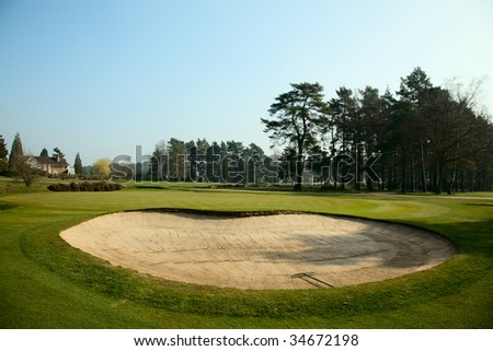 pit with sand on a golf field