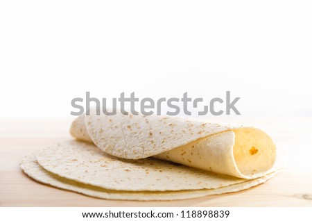 Pita bread on kitchen wooden plank