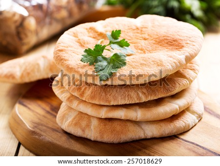 pita bread on wooden board - stock photo