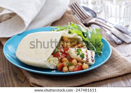Pita bread stuffed with cheese, couscous and chickpeas - stock photo