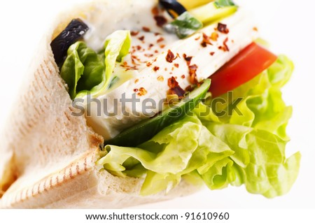 Pita bread stuffed with Feta and vegetables - stock photo