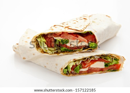 pita bread stuffed with meat, cheese, tomatoes, green salad on white background - stock photo