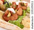 pita bread with falafel and vegetables - stock photo