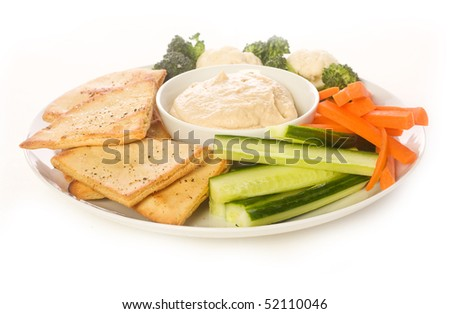 Pita chips and fresh vegetable make a healthy appetizer or snack along with hummus - stock photo