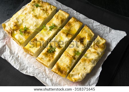 PITA pie with cheese and herbs   - stock photo