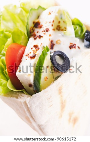 Pita stuffed with feta and vegetables - stock photo