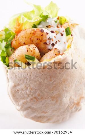 PIta stuffed with king prawn and yoghurt dip - stock photo