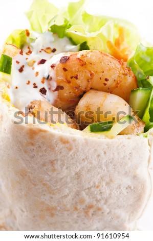 Pita stuffed with prawn and salad - stock photo