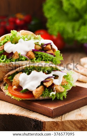 Pita with roasted chicken and vegetables, served with a delicious sauce