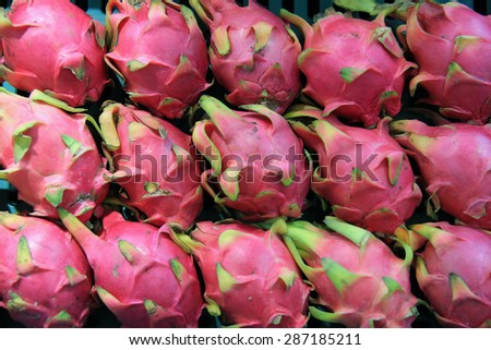 Pitaya or Dragon Fruit is a beautiful fruit grown in Southeast Asia, Mexico, Central and South America and Israel. It offers numerous nutrients with low calories. - stock photo