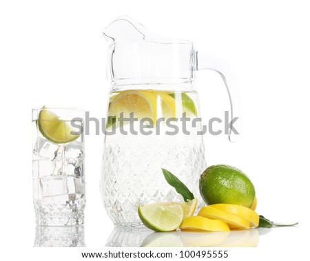 pitcher and glass of lemonade and lemon isolated on white - stock photo